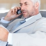 bigstockphoto_Business_Man_Communicating_On__5120319-200x150